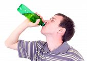 The Young Man Drinks From A Green Bottle