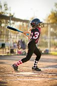 Child playing softball or baseball game poster