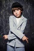 Modern cool boy looking at camera. Kids fashion. poster