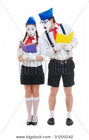 two mimes with books. isolated on white