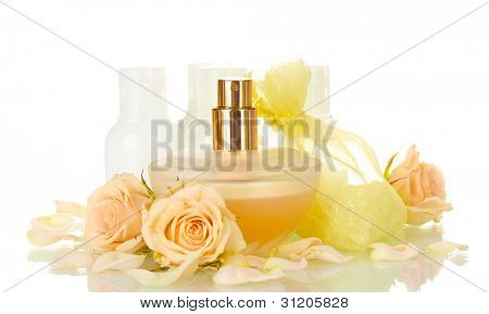 Hotel amenities kit and perfume on white background