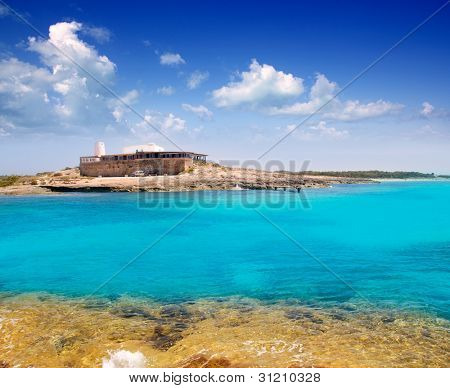 Rocky shore of formentera turquoise sea in Illetes