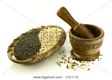 A Plateful Of Bean And A Mortar With Pestle