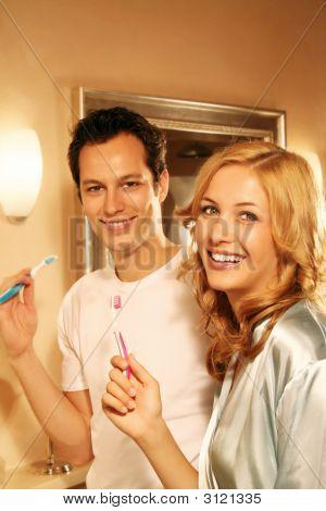 A Couple In Thair Bath Cleaning Their Teeth