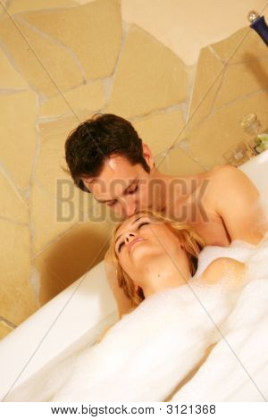 A Couple Is Taking A Bath