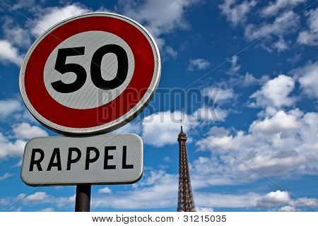 Road Traffic Sign with Eiffel Tower in Distance