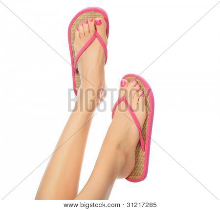 Funny pink sandals on female feet. Isolated on white background