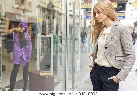 Woman In Shoping Street Looking At Window