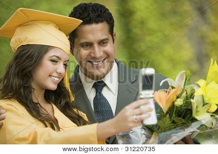 Father and Daughter Taking Picture at Graduation