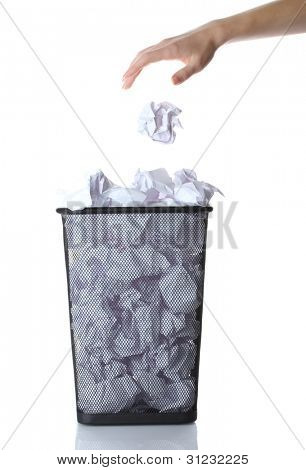 hand going garbage in metal trash bin from paper isolated on white