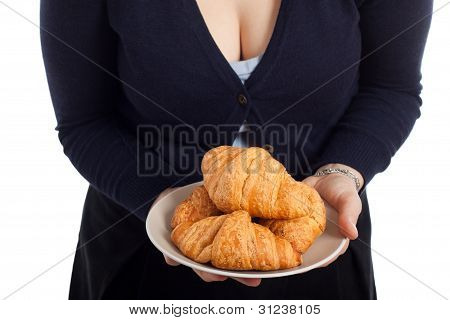 Woman Holding Plate With Fresh Croissants
