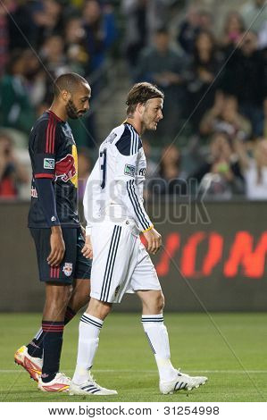 CARSON, CA. - MAY 7: New York Red Bulls F Thierry Henry #14 (L) & Los Angeles Galaxy M David Beckham #23 (R) walk off the pitch together after the MLS game on May 7 2011 at the Home Depot Center in Carson, CA