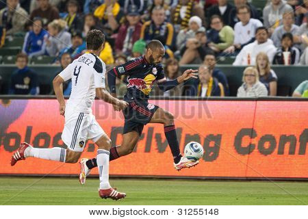 CARSON, CA. - MAY 7: New York Red Bulls F Thierry Henry #14 (R) gets past Los Angeles Galaxy D Omar Gonzalez #4 (L) during the MLS game on May 7 2011 at the Home Depot Center in Carson, CA