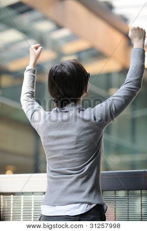 business woman spread arms and representing freedom success and winner concept