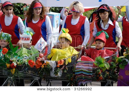 Women And Kids In Shopping Trolleys