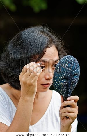 Young Woman Picking Eyebrow