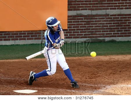 College Softball Player Swinging