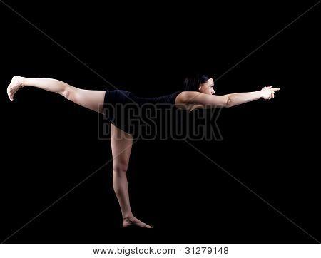woman in dark exercise yoga balance asana