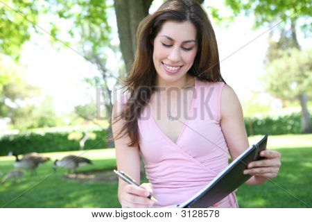 Pretty Woman Studying Under Tree