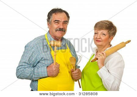 Mature Couple Holding Kitchen Utensils