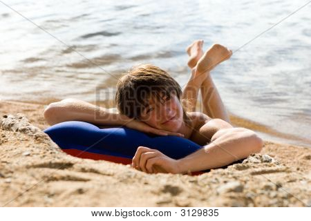 Boy On Air-Bed At Sunny Beach (Series Sport, Mountains, Extreme, Horses, Teenagers)