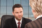 stock photo of business meetings  - white business man and woman talking in the office building - JPG