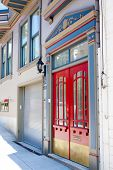 pic of entryway  - Red doors highlight the entryway to an historic home in downtown San Francisco - JPG
