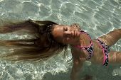 picture of 13 year old  - 13 years old caucasian girl is in the swimming pool - JPG