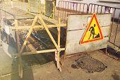 Damaged Asphalt Road. Repair Of Engineering Road Highways. Bad Road. Repair Sign On The Road. poster