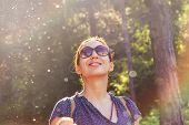 Beautiful Woman Smiling In Nature. Happy People Lifestyle. Woman Smiling In Sunshine With Water Drop poster