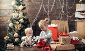 Child With A Christmas Present On Wooden Background. Winter Kids. Kid Enjoy The Holiday. Christmas C poster