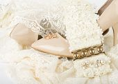 image of wench  - Beautiful wedding accessories and shoes on a white background - JPG