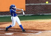 stock photo of fastpitch  - College softball player at the plate after making contact with the softball - JPG