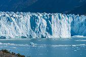 Amazing View Of Perito Moreno Glacier, Blue Ice Burg Glacier From Peak Of The Mountain Through The A poster
