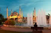 Man Sitting On A Bench Near Of Blue Mosque