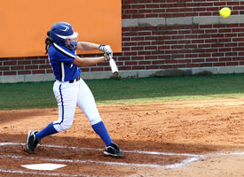 picture of softball  - College softball player at the plate after making contact with the softball - JPG