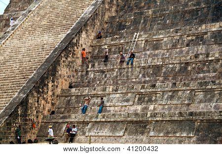 Maintenance Workers In Chichen Itza Pyramid