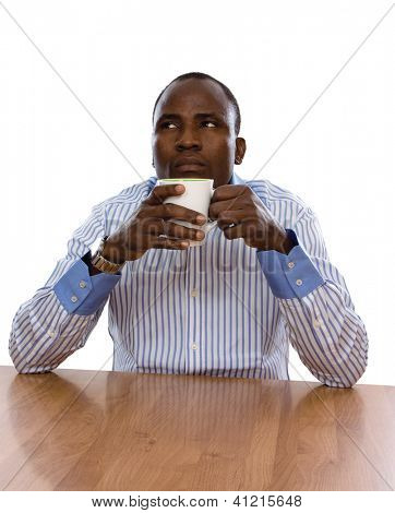 African-american with coffee at desk isolated on white