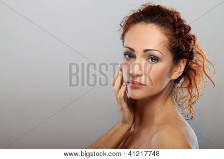 Beautiful natural middle aged woman  isolated on grey background