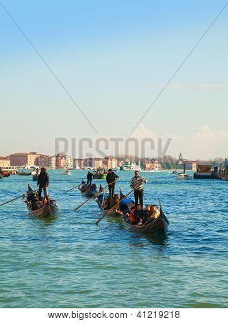 Gondolas With Tourists At Grand Canal In Venice