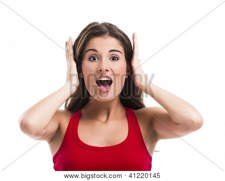 Beautiful young woman covering her ears with hands, isolated over a white background
