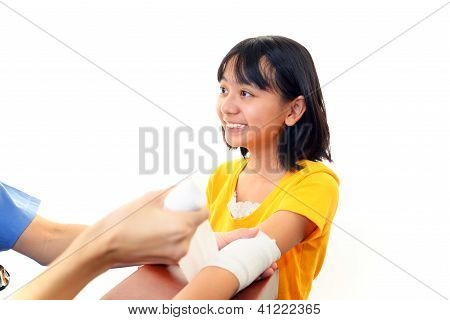 Orthopedic surgeon with patient