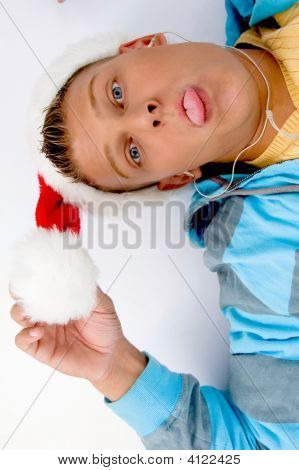 Man Holding Christmas Hat And Pulling His Face
