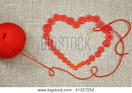 Heart In Shape Of Red Buttons, Needle And Yarn