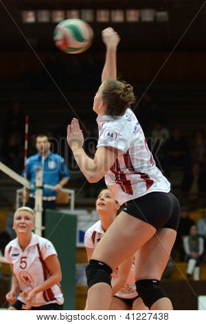 KAPOSVAR, HUNGARY - JANUARY 13: Zsanett Pinter (R) in action at the Hungarian I. League volleyball game Kaposvar (white) vs Budapest SE (white), January 13, 2013 in Kaposvar, Hungary.