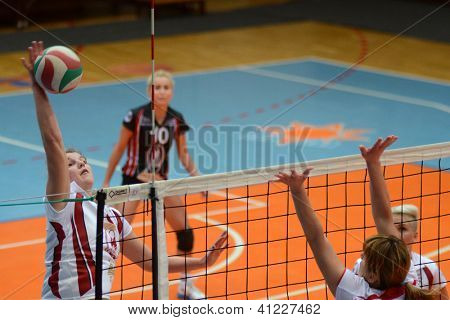 KAPOSVAR, HUNGARY - JANUARY 13: Timea Kondor (L) in action at the Hungarian I. League volleyball game Kaposvar (white) vs Budapest SE (white), January 13, 2013 in Kaposvar, Hungary.