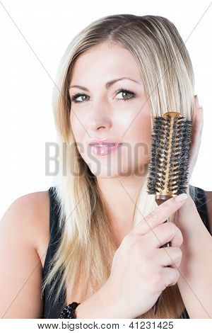 Portrait Of Beautiful  Woman Combing Her Blondy Hair On Isolated White Background