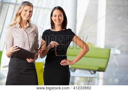 Businesswomen Having Informal Meeting In Modern Office