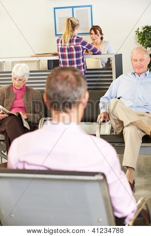 Patients In Doctor's Waiting Room