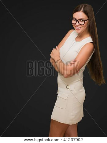 Happy Woman wearing glasses against a black background